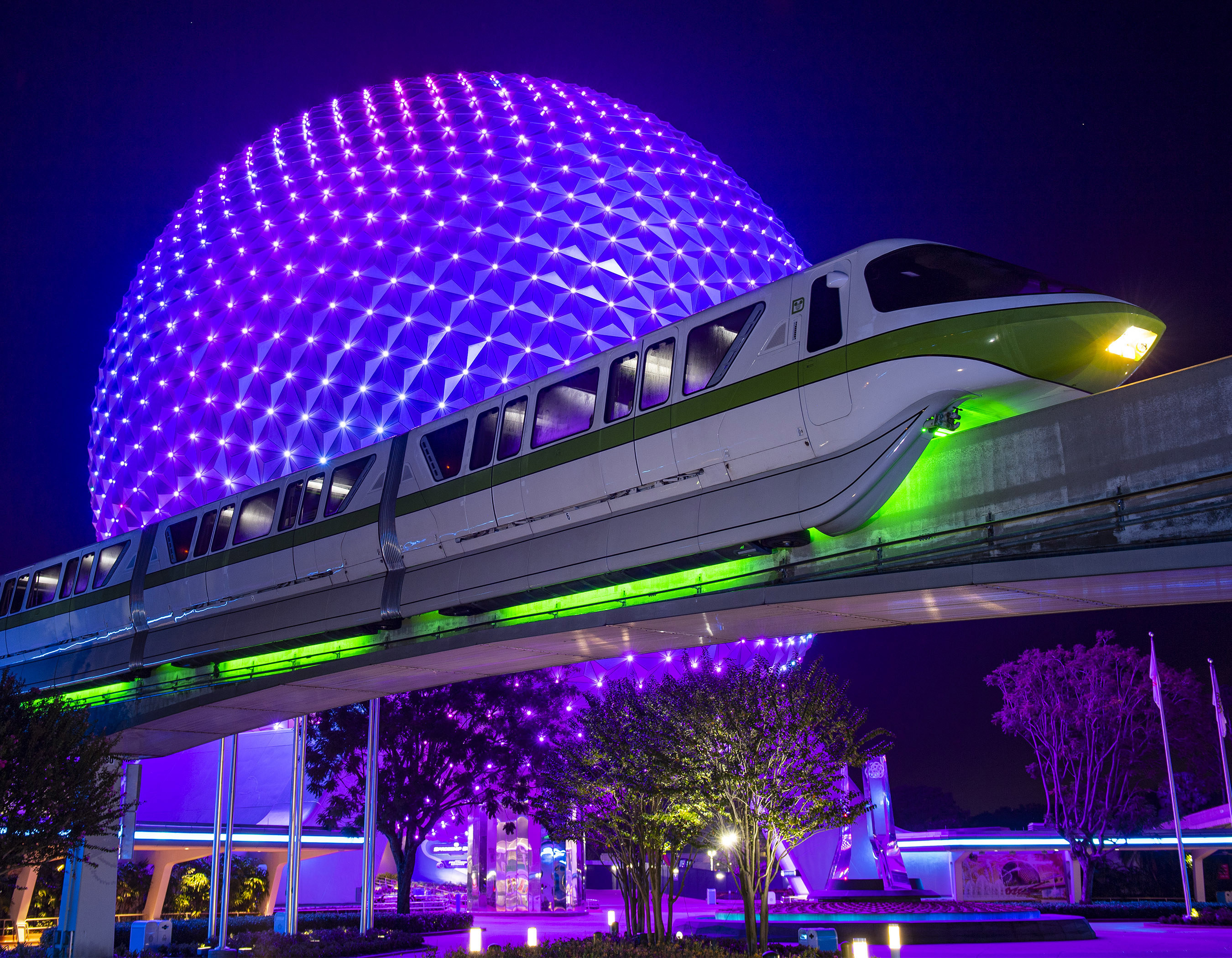 The monorail going in front of Epcot with the underside glowing