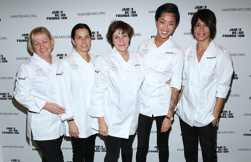 Lynch standing in the middle of a group of five female chefs