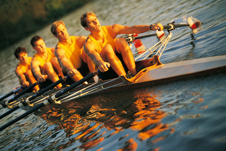 Four men rowing the boat