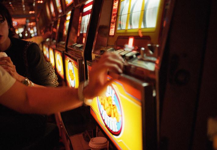 Someone gambling at a slot machine
