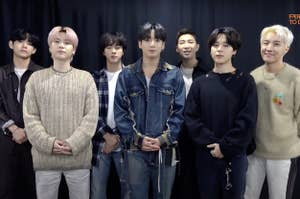 BTS poses together and smiles
