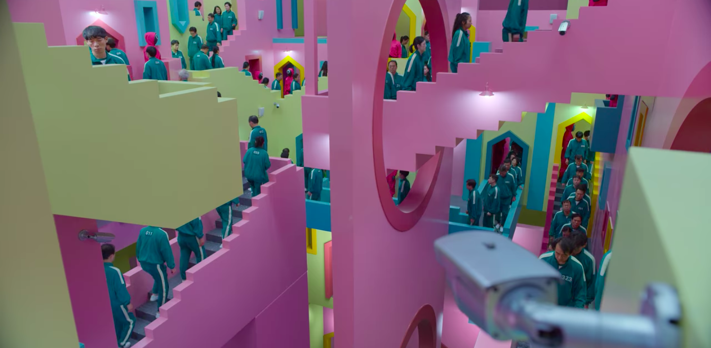 Pink, green and blue mansion that the contestants walk through
