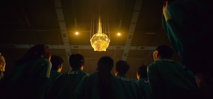 the contestants staring at the glowing ball of cash that they can win