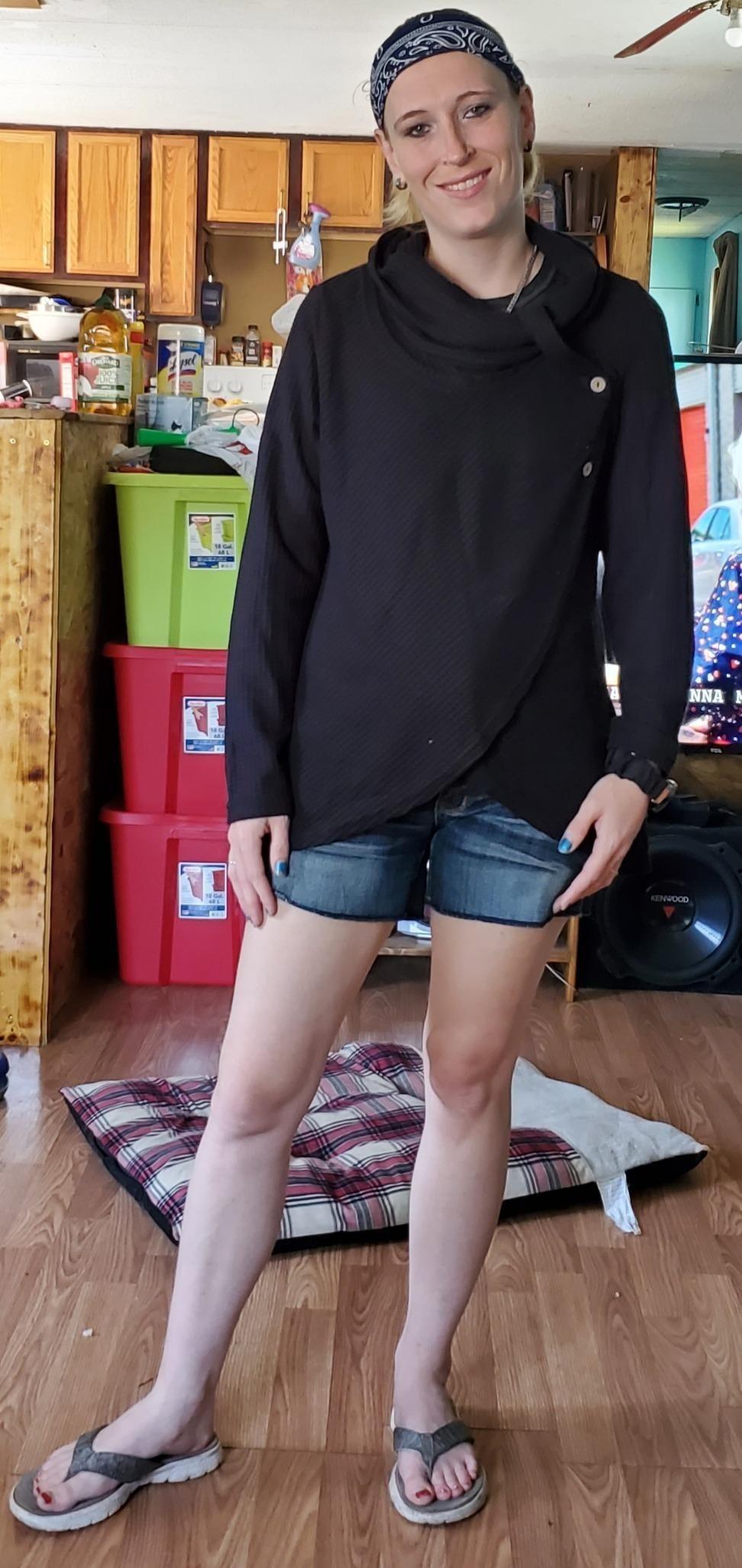 Model wearing black cowl neck wrap sweater