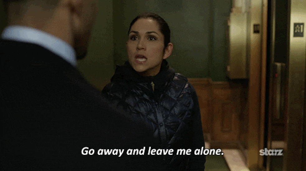 A woman telling a man to go away and leave her alone