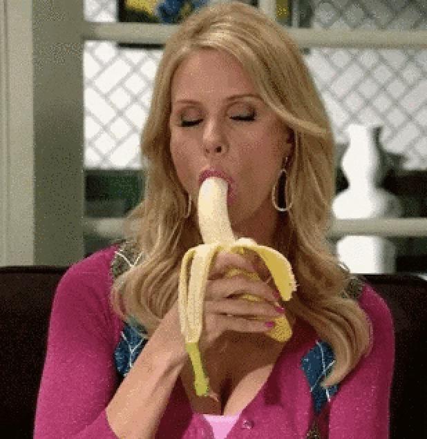 A woman eating a banana