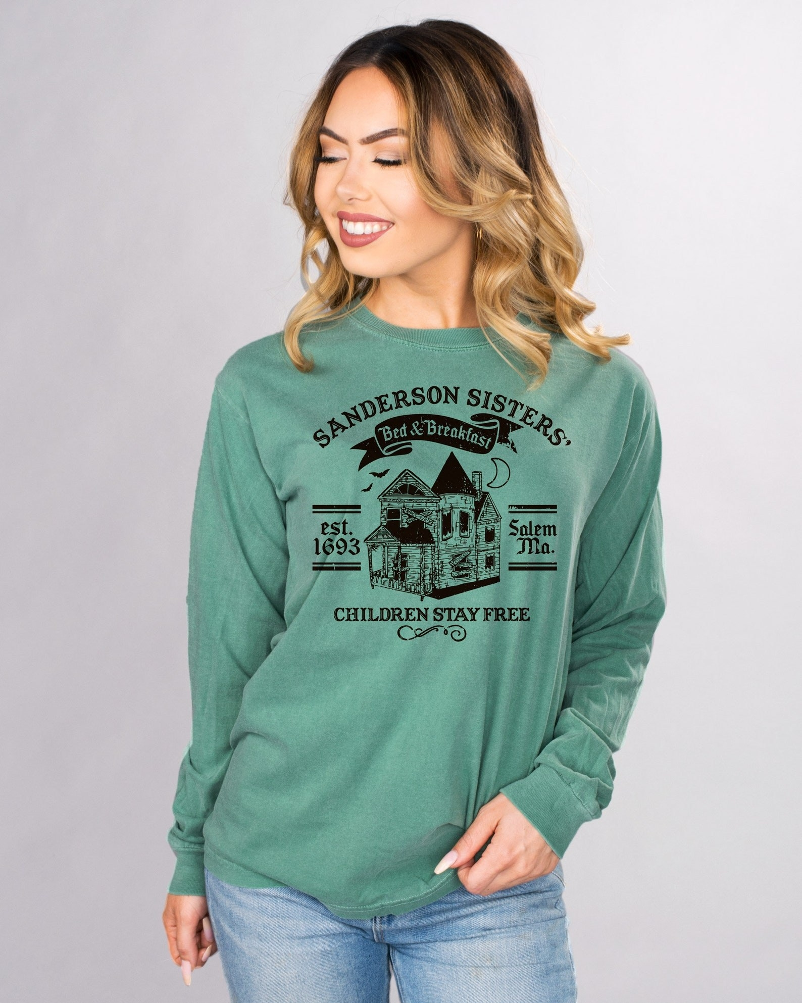 Model wearing green sweatshirt