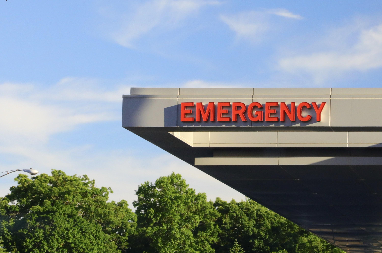 """Emergency "" sign outside a hospital's emergency room"