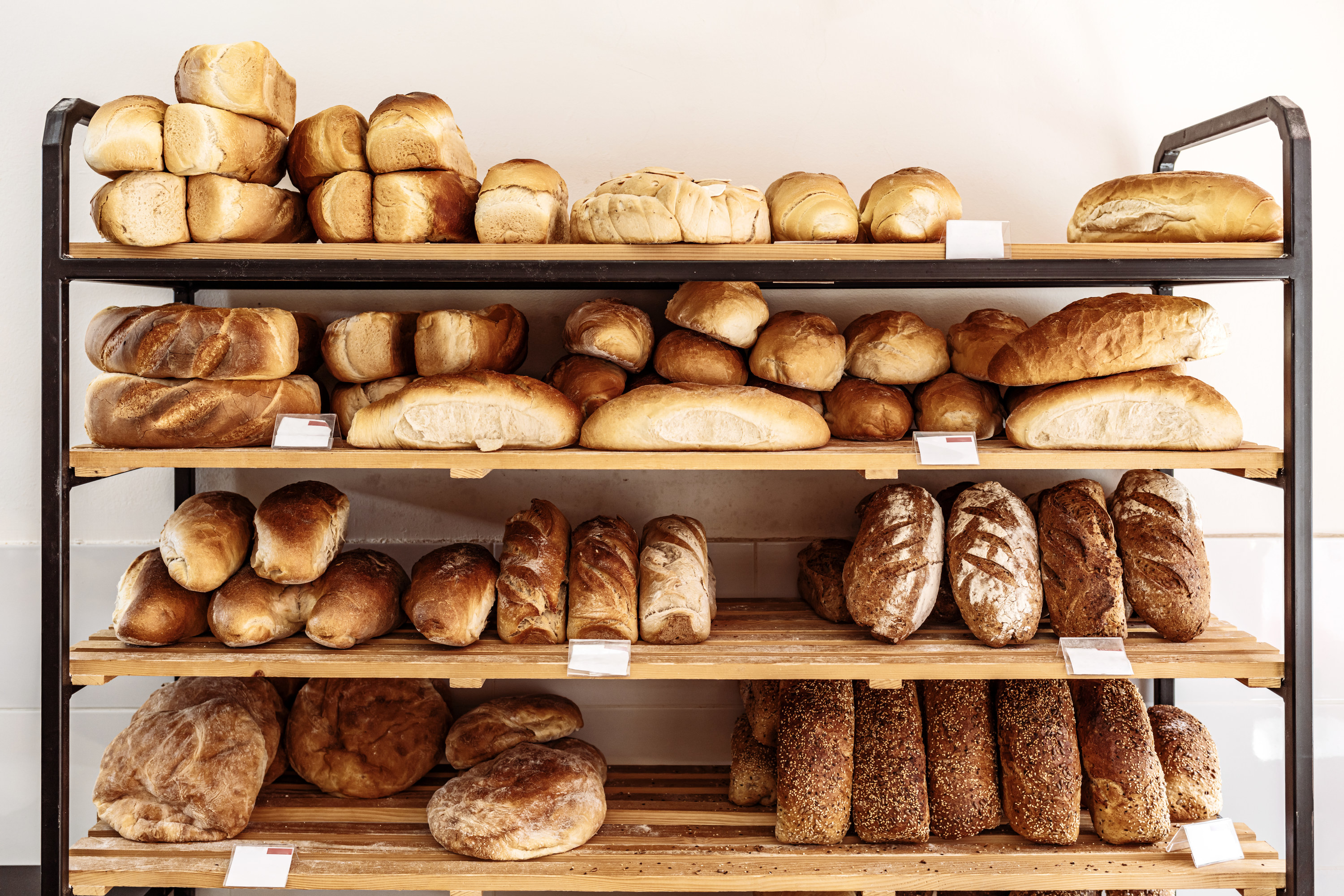 Bakery shelf lined with freshly-baked bread