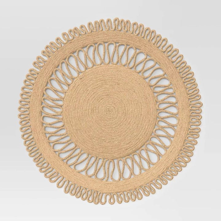 the tan circle mat with squigly lines connecting the inner circle to the outer circle