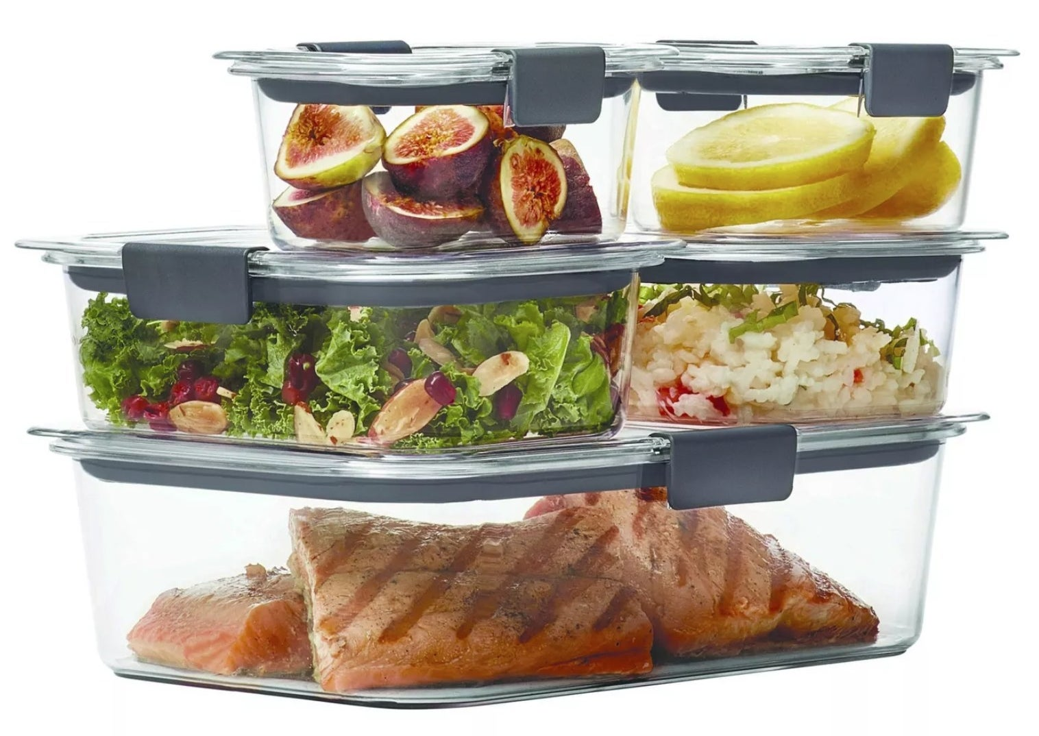 the five containers stacked on top of each other with salmon in the big bottom one, salad and rice in the two medium ones on top of the bottom one, and lemon and dates in the two small ones on top of the medium ones