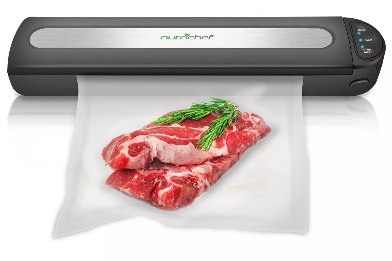 the vacuum sealer with steak and an herb in a bag being sealed