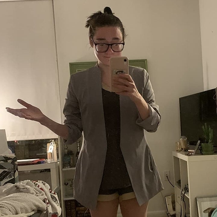 a reviewer wearing the blazer with shorts