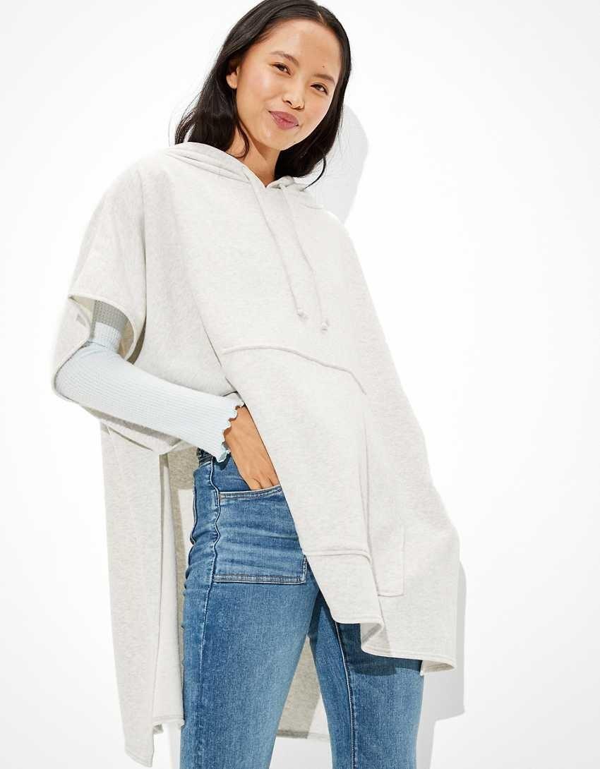 model wearing gray oversized hoodie poncho
