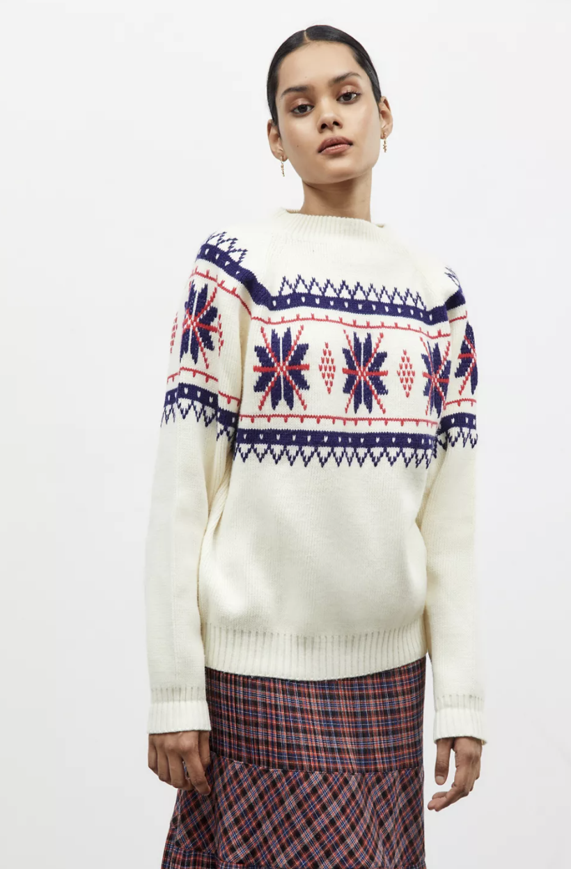 model wearing sweater with skirt