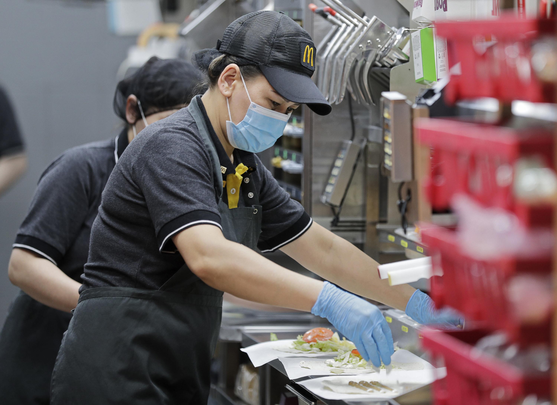 Fast food worker preparing food in a McDonald's