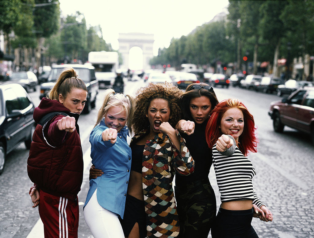 the girls doing a girl power punch in paris