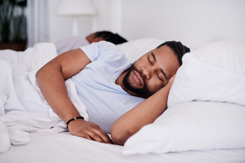 A husband and wife sleeping