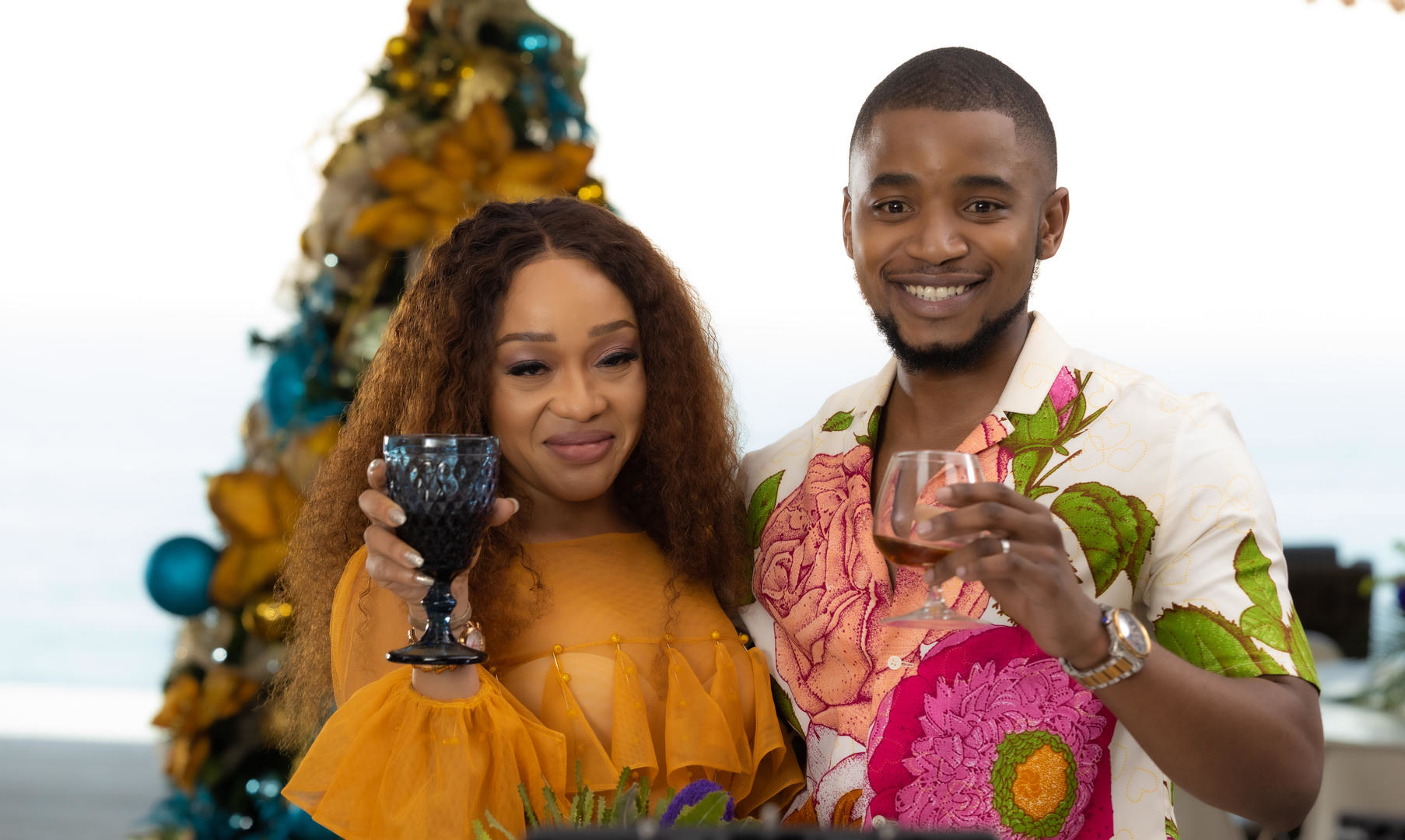 Two people raising their glasses in a toast