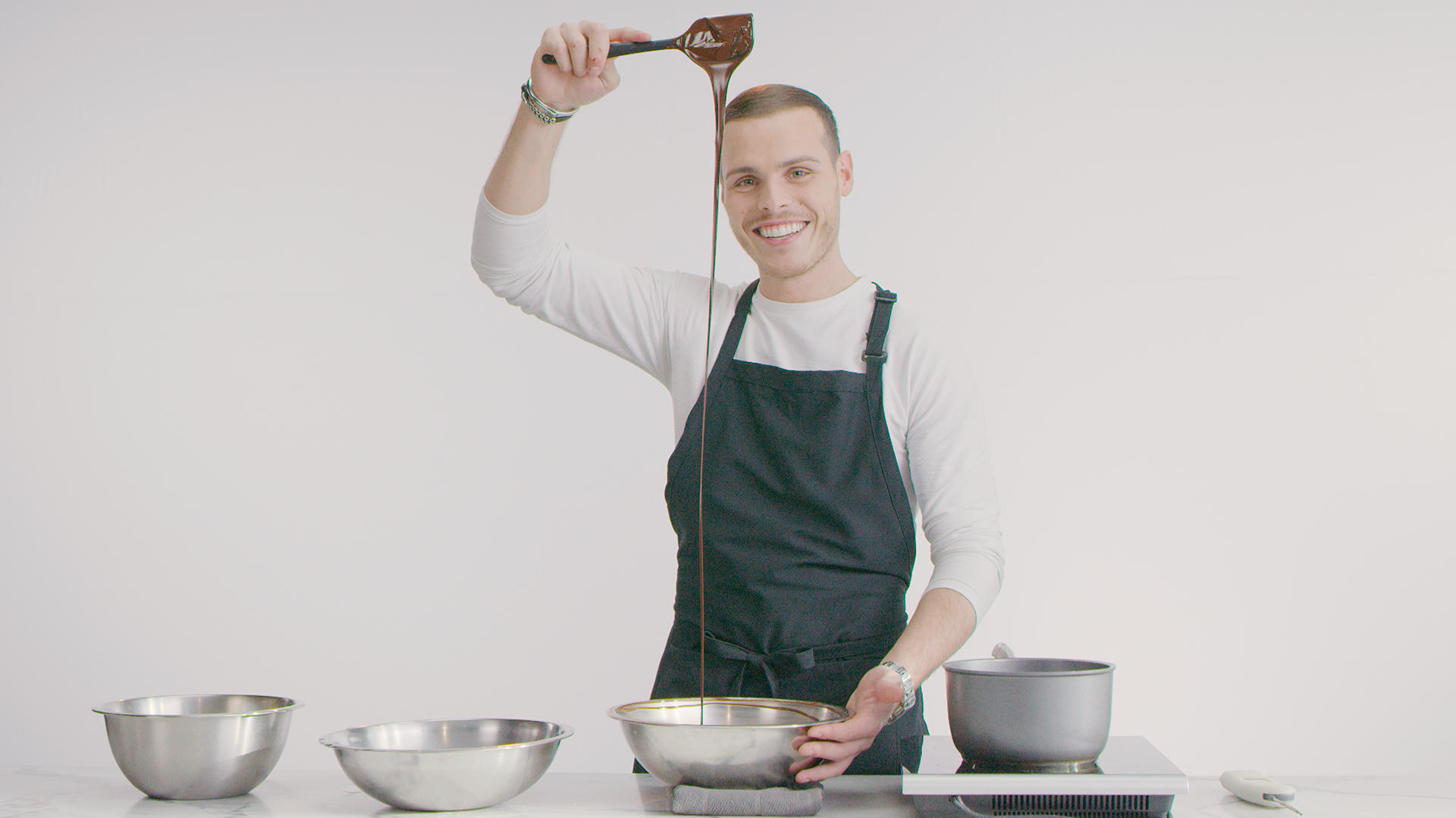 A man working with melted chocolate