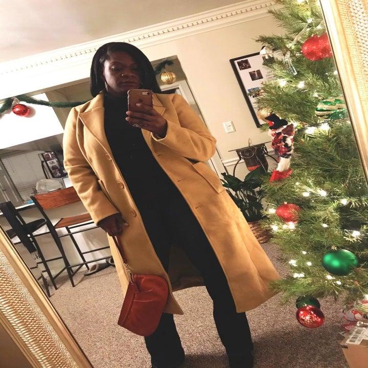 reviewer wearing the coat in beige