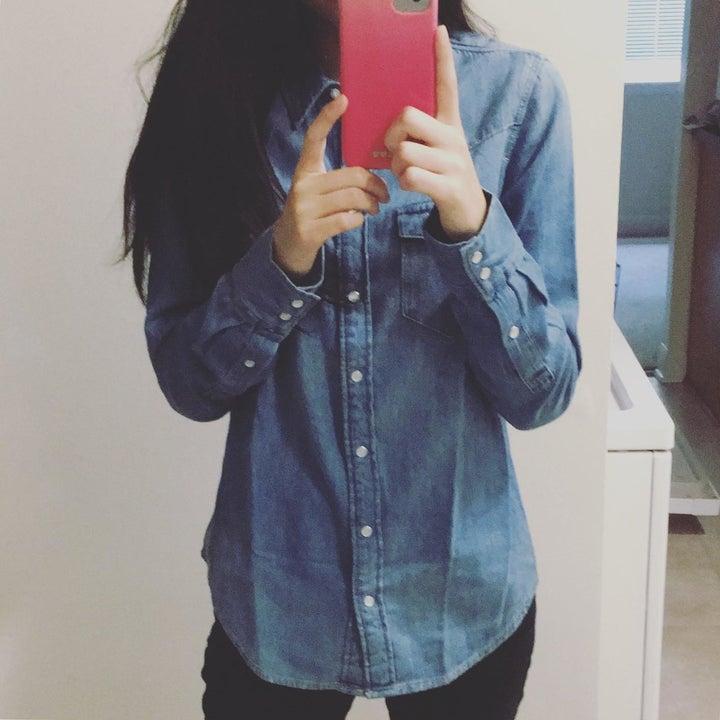reviewer wearing denim shirt buttoned
