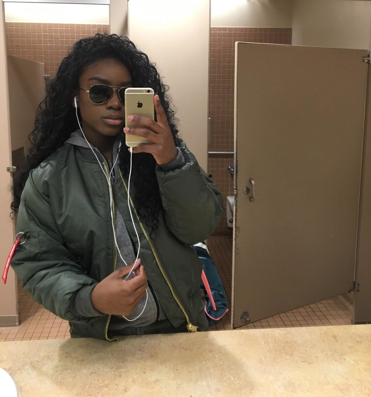 reviewer wearing the bomber in green