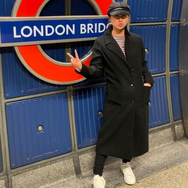 reviewer wearing coat in black