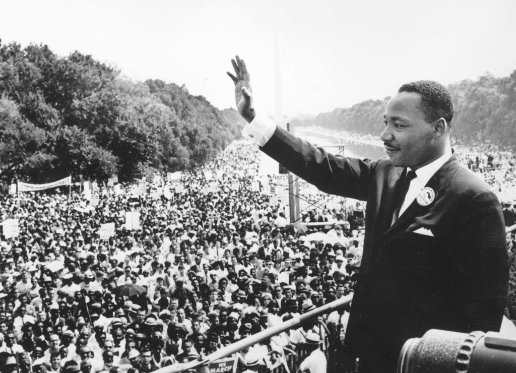"""Martin Luther King waving during his """"I have a dream"""" speech"""