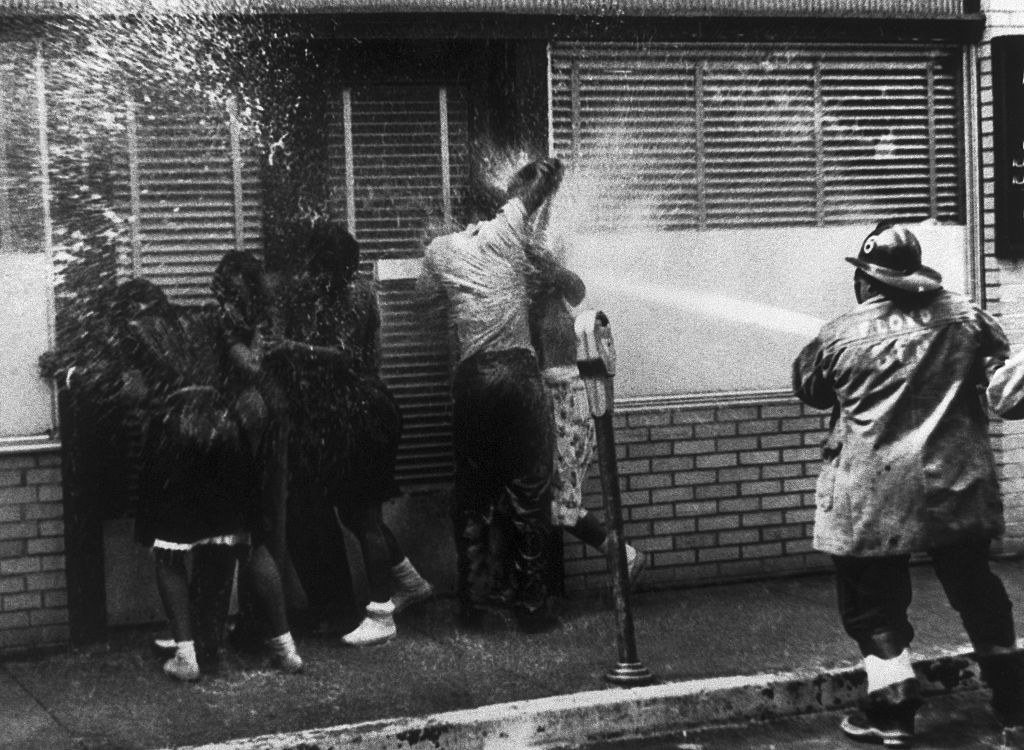 firefighters spraying Black protestors with a hose