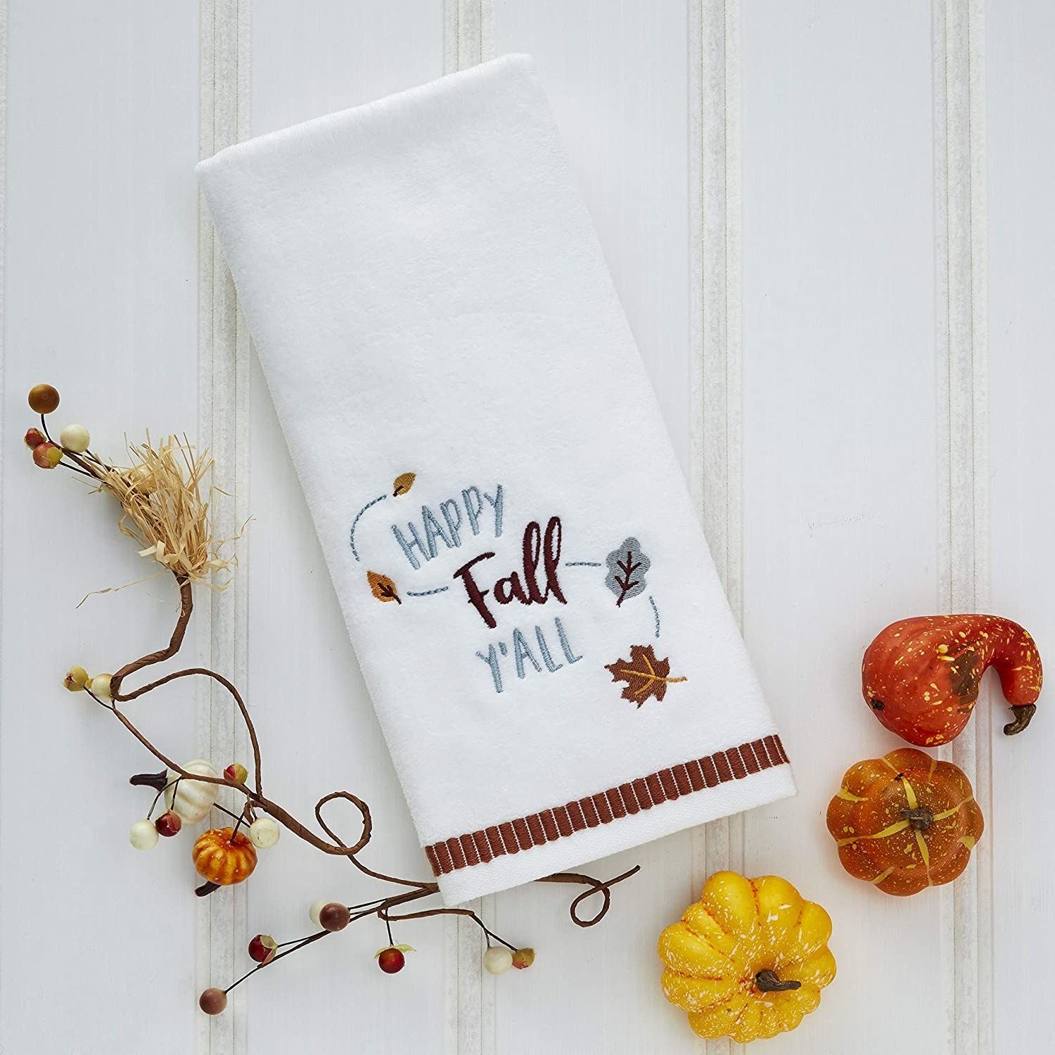 """White hand towels with the words """"Happy Fall Y'all"""" embroidered on in blue and brown"""