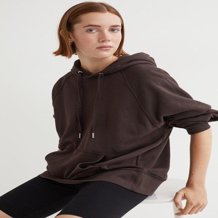an oversized brown hoodie