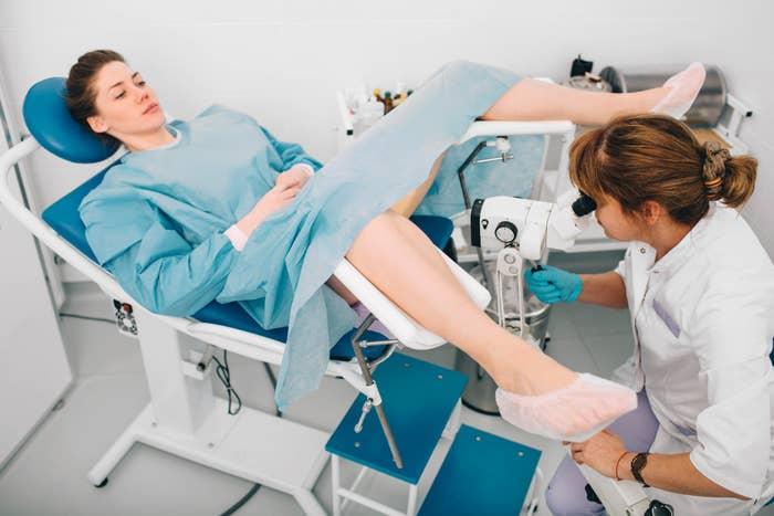 A woman getting a colposcopy