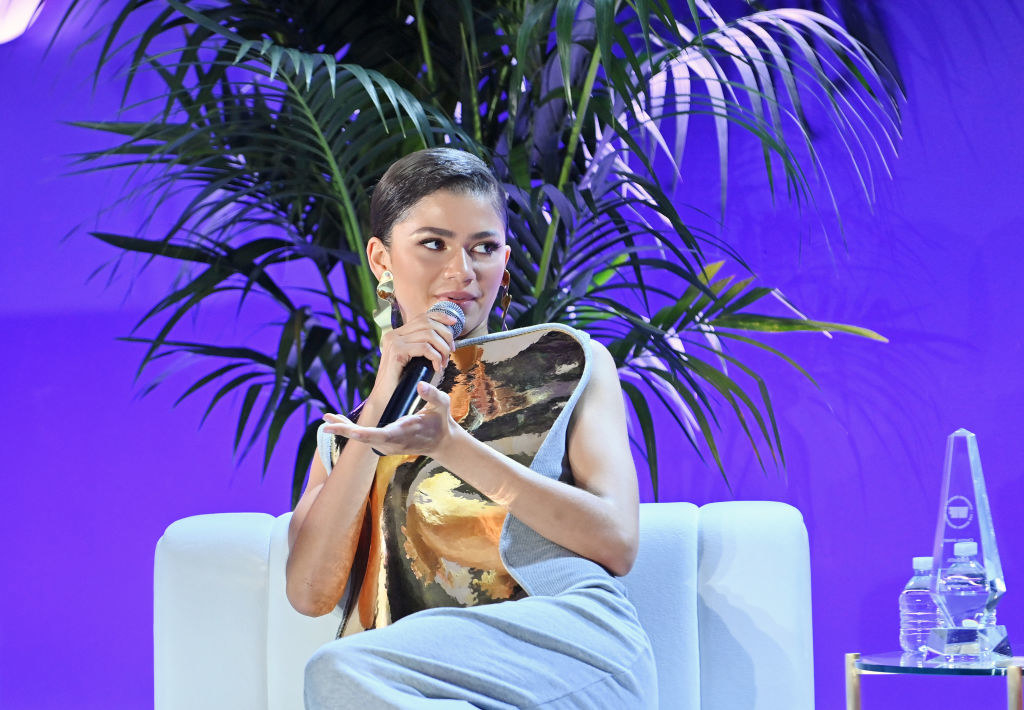 Zendaya sitting as she speaks during an interview