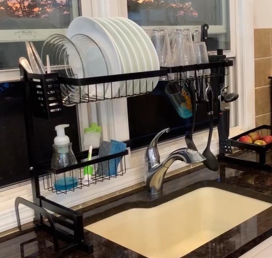 reviewer image of the drying rack over a sink with plates, cups, silverware, and washing tools in the different sections