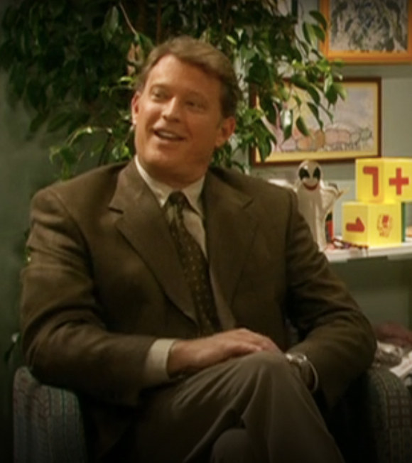 Brock sits in the therapist's office
