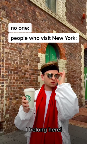 """Pavel wearing sunglasses and holding a Starbucks cup wit the caption """"I belong here!"""""""
