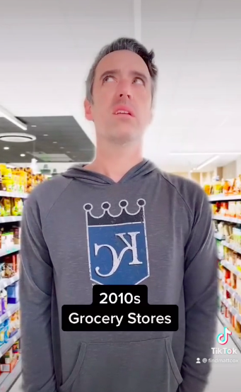 a man looking concerned that he hears torn in the grocery store