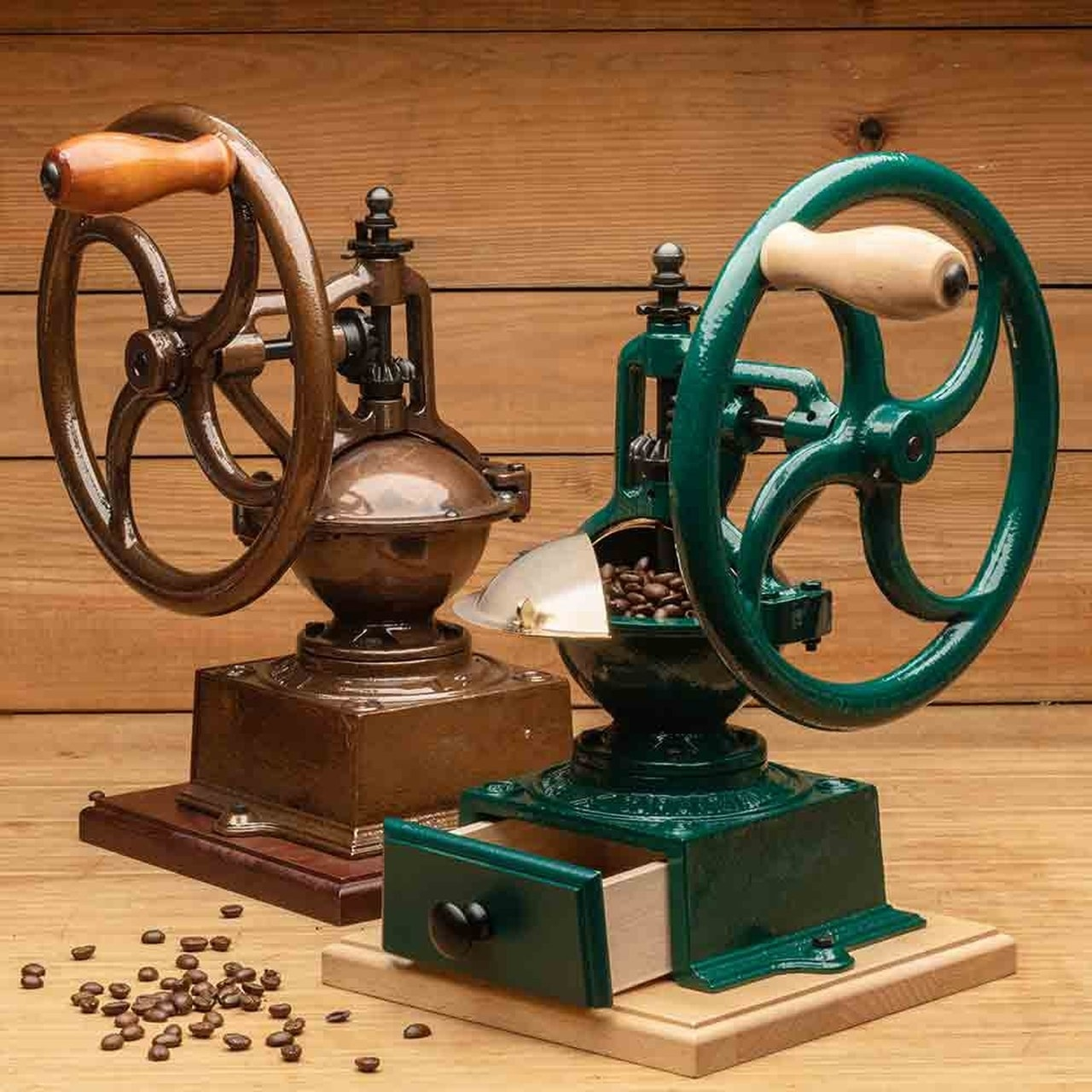 two coffee grinders with wheel grinding system and a bean storage shelf