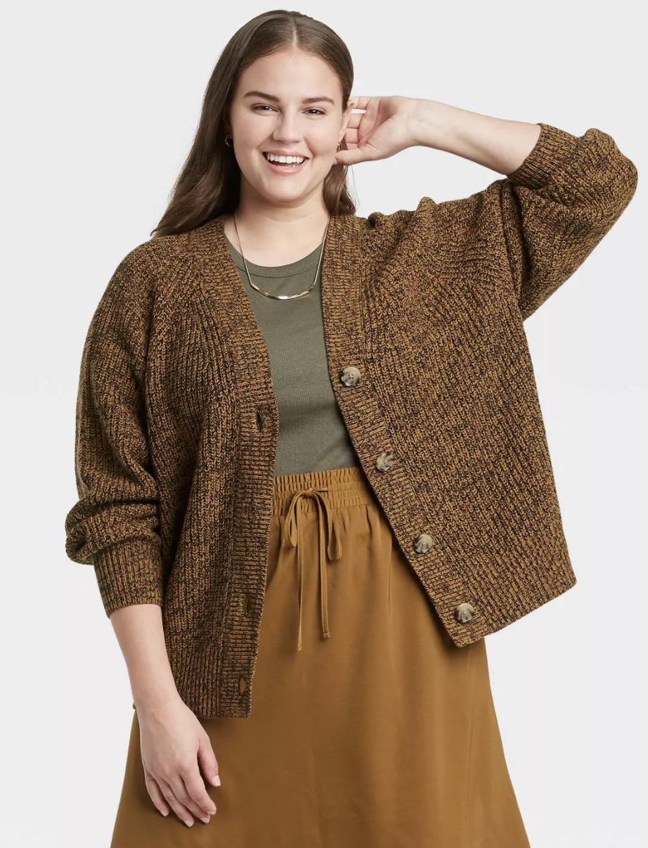 Model wearing brown sweater