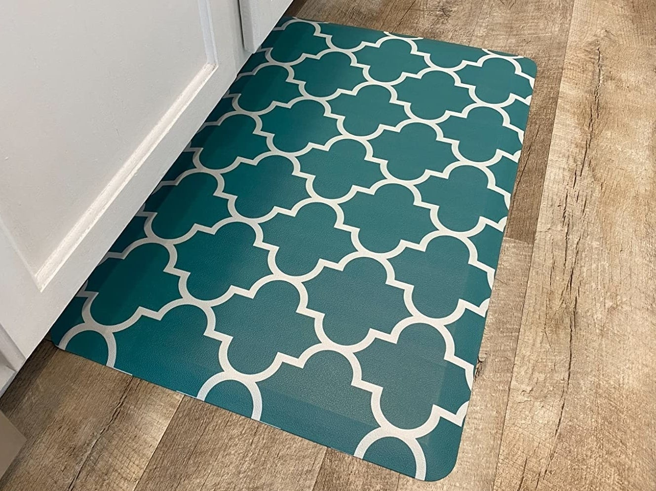 Reviewer photo of the kitchen mat on a hardwood floor