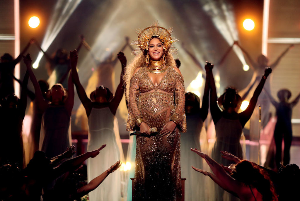 A pregnant performing at the Grammys