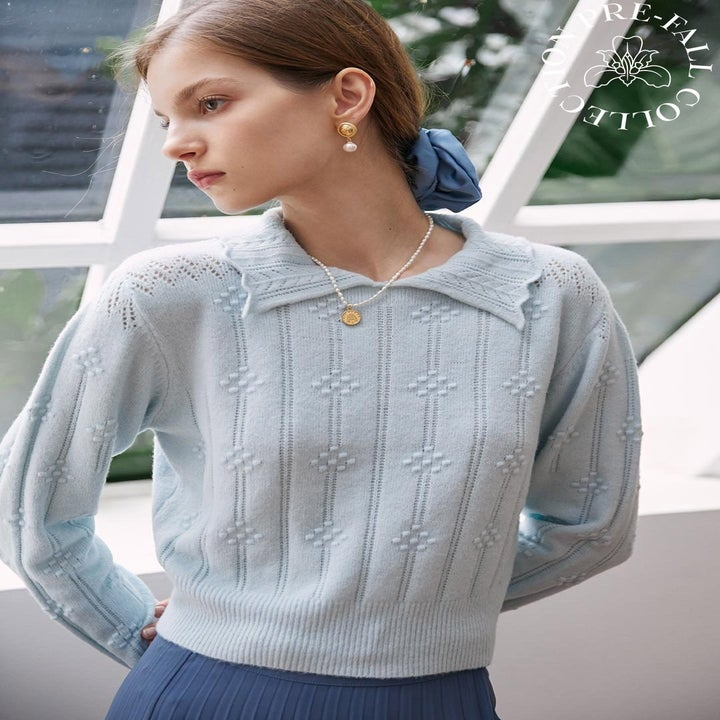 the sweater in pale blue
