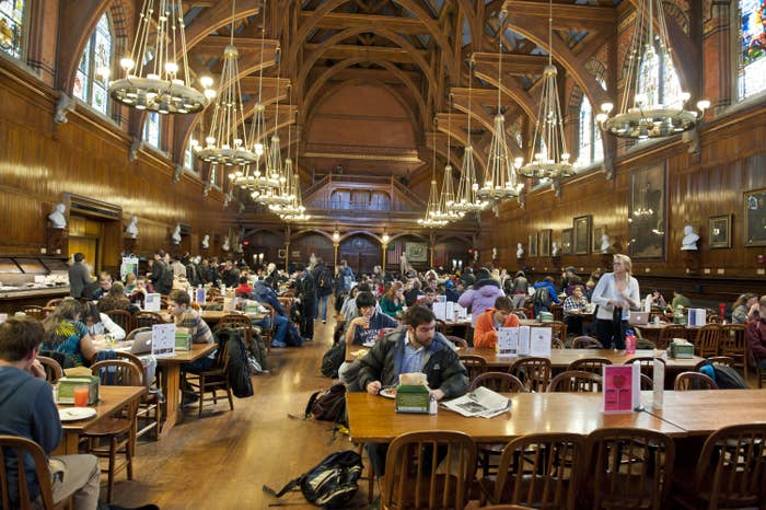 A fancy looking dining hall with chandlers and high ceilings