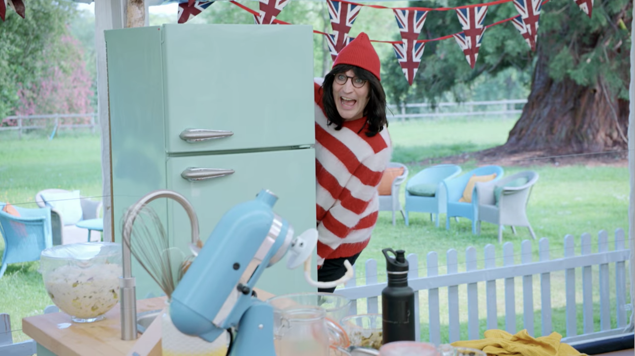 Noel in a Where's Waldo costume with a hat and glasses