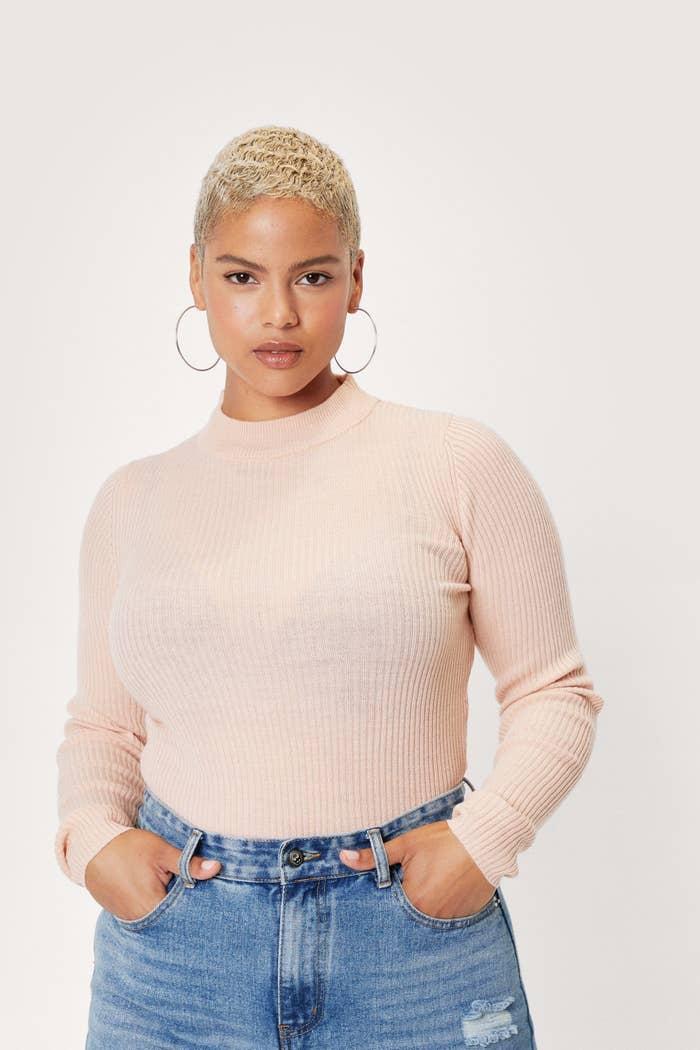 Model wearing beige sweater
