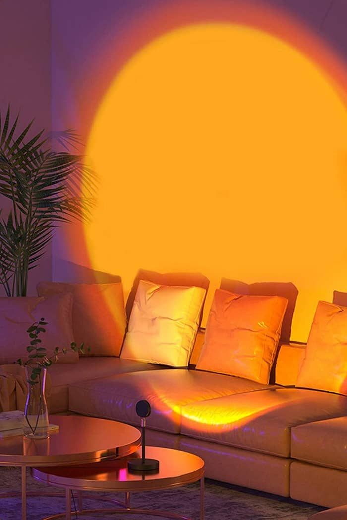 The sunset light projected onto a living room wall