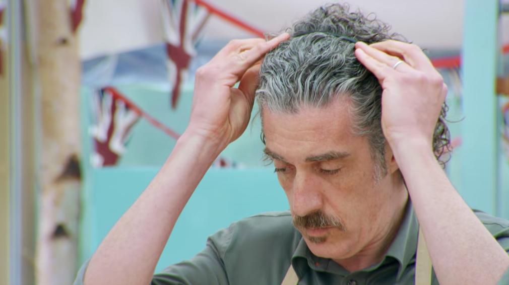 Giuseppe putting in his headband