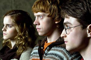Hermione Granger, Ron Weasley, and Harry Potter look off into the distance