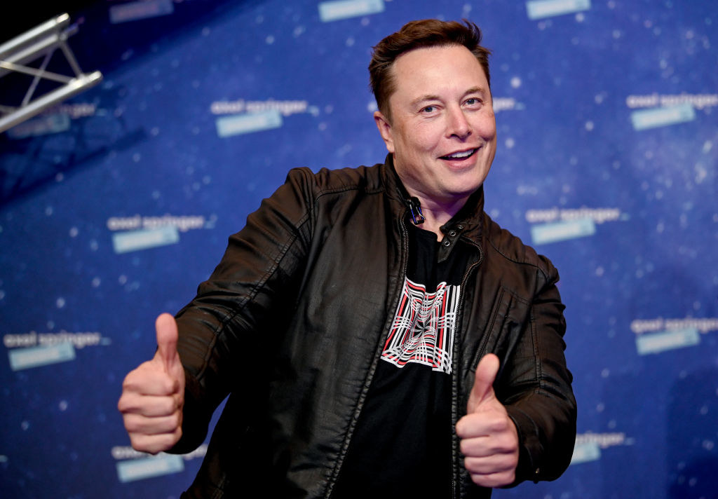 Elon Musk giving a thumbs-up